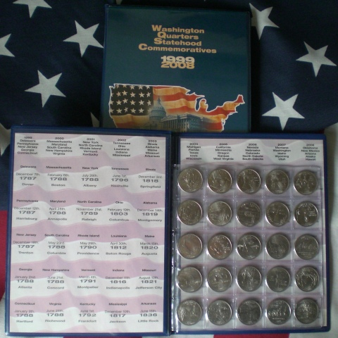 Two page album-holds 56 Quarters, one from each state plus our album now include
